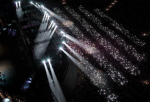 Aerial shot of cocnert crowd with light patterns